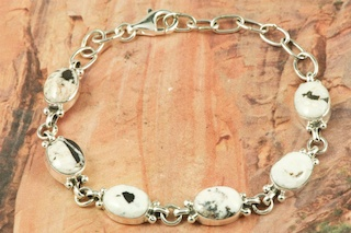 6 Beautiful White Buffalo Turquoise Stones set in Sterling Silver Link Bracelet. This Beautiful Stone is formed from the minerals Calcite and Iron. It is mined near Tonopah Nevada. This Beautiful Bracelet is a one of a kind Bracelet. The photo is of the jewelry you will be receiving. Created by Navajo Artist Geneva Chavez. Signed by the artist.